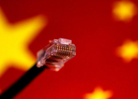 FILE PHOTO: Illustration photo of a computer network cable above a Chinese flag